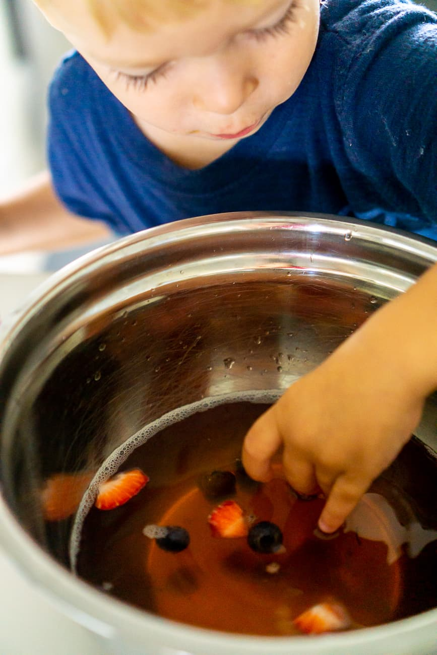 jello sensory activity - toddler making jello