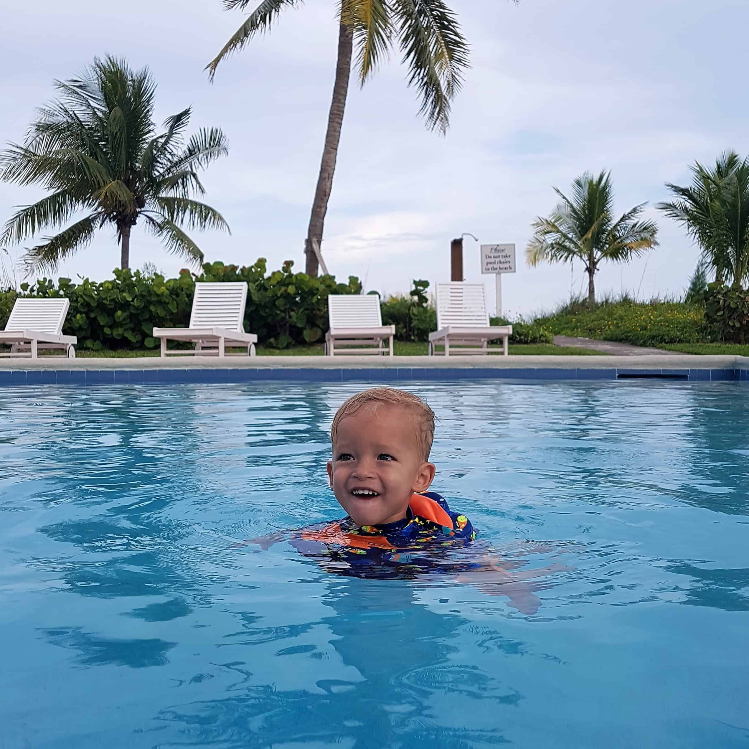 toddler swimming independently