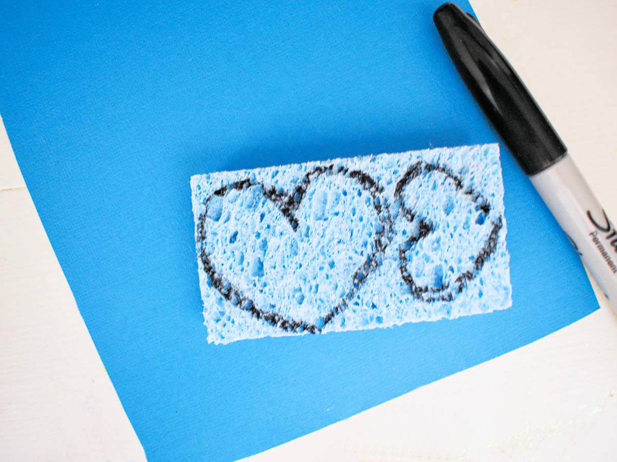 2 hearts drawn on a sponge to do a toddler sensory activity