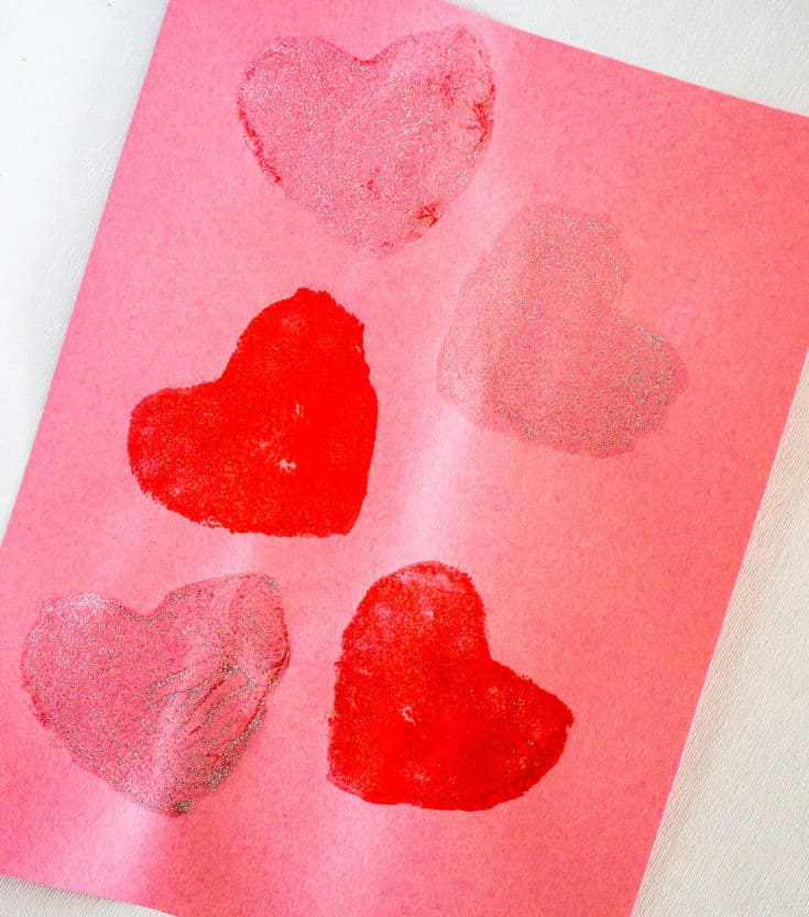 heart-shaped sponge stamp on construction paper - valentine's day toddler activity