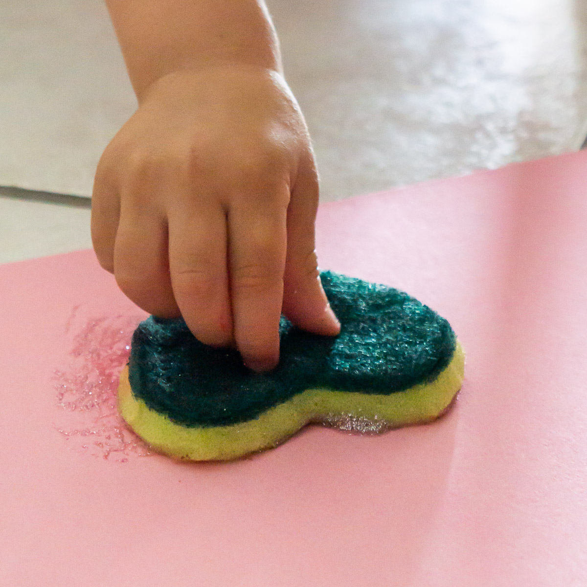 toddler painting with a sponge