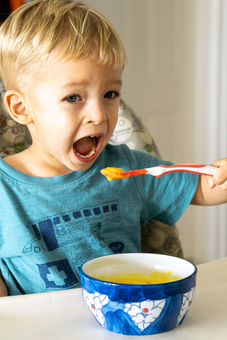 toddler eating vegetable soup