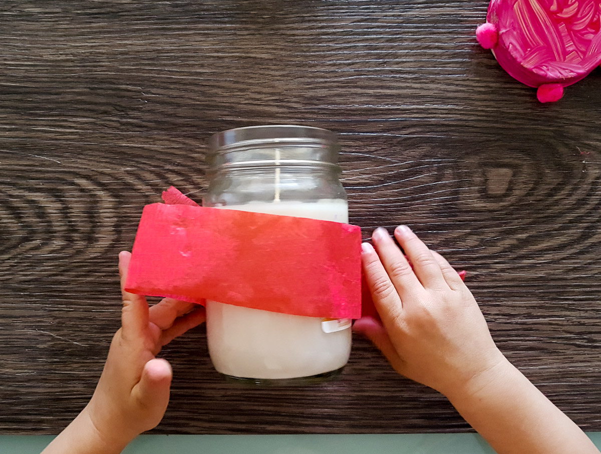 toddler decorating a candle
