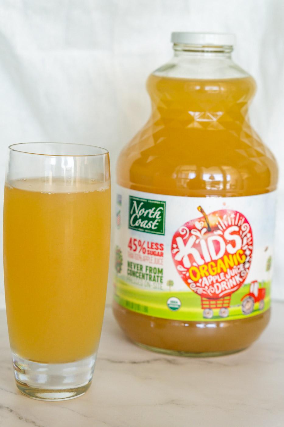 north coast organic apple juice drink bottle and glass