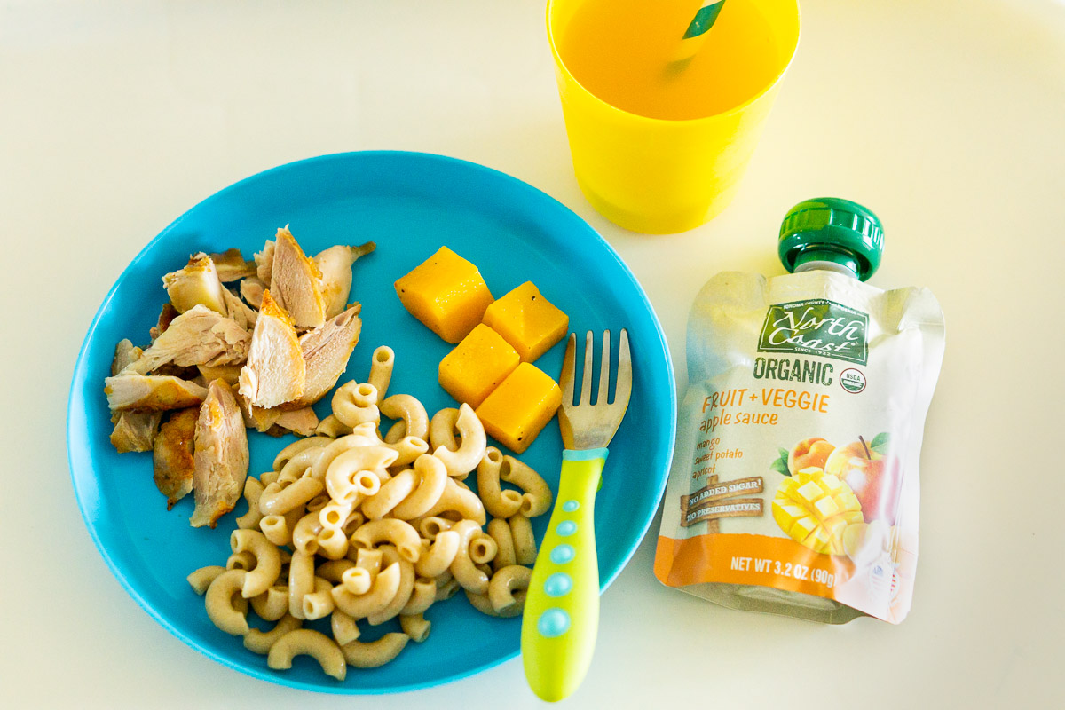 toddler dinner on a plate with a fruit pouch