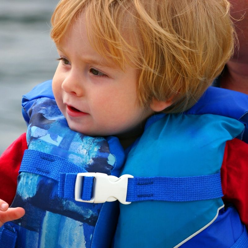 toddler in a life vest