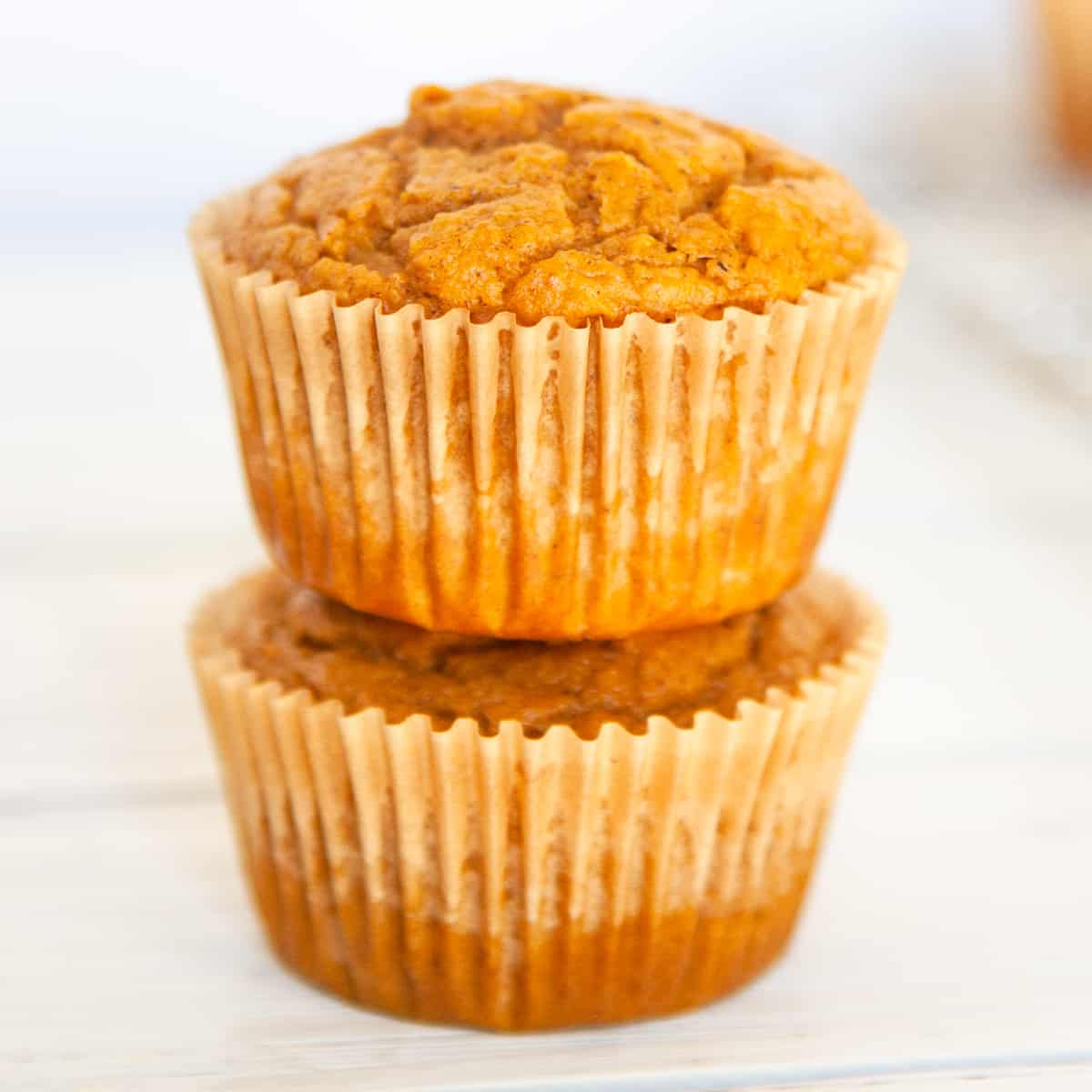 2 pumpkin muffins stacked on each other