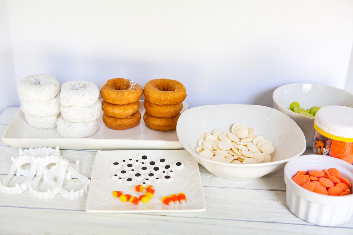 ingredients for making Halloween monster donuts - donuts, candy melts, candy eyes, Halloween sprinkles