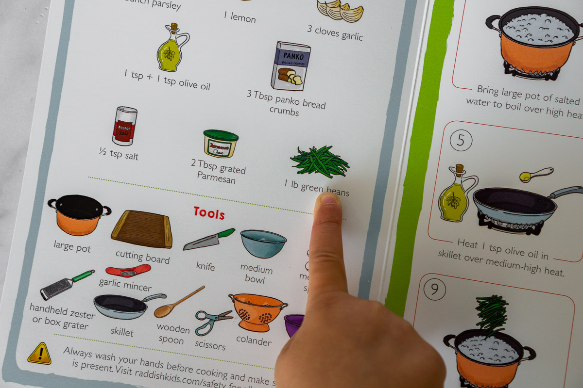 toddler pointing to ingredients from Raddish Kids recipe