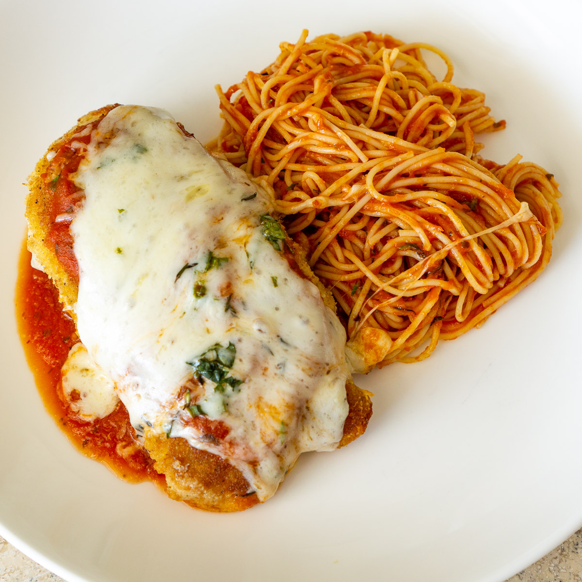 chicken parm with spaghetti on a plate - made from a Raddish Kids recipe