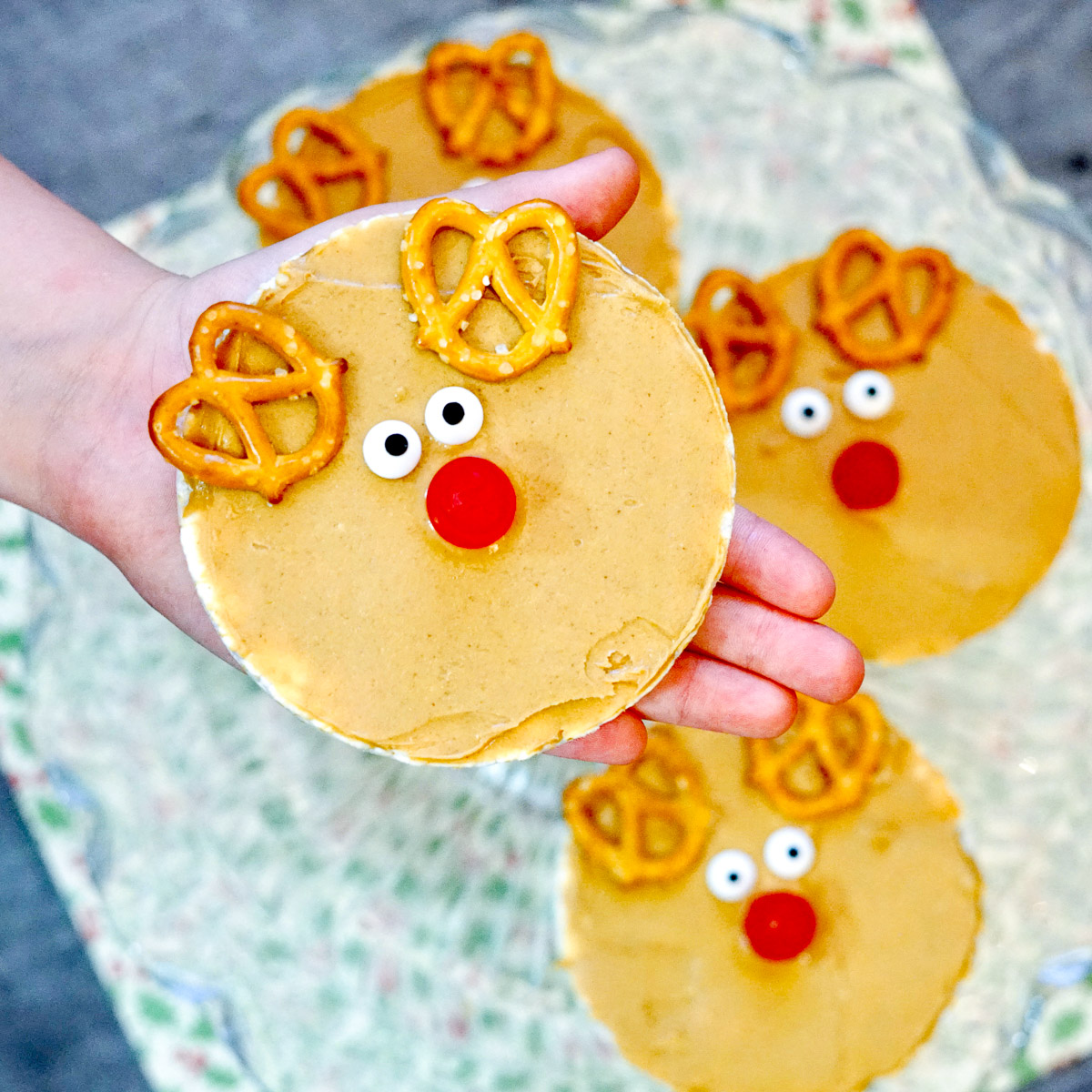 child holding peanut butter rice cake rudolph snack