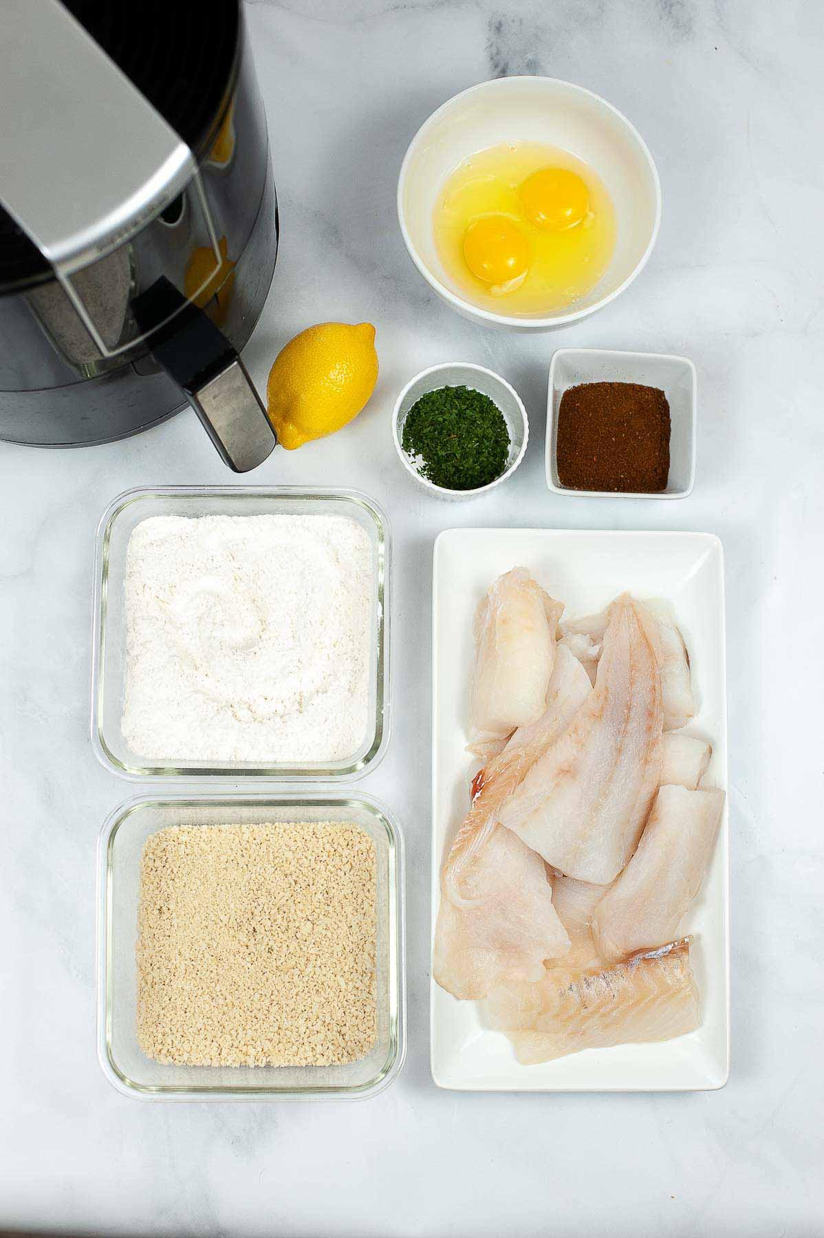 Ingredients to make air fryer fish sticks.
