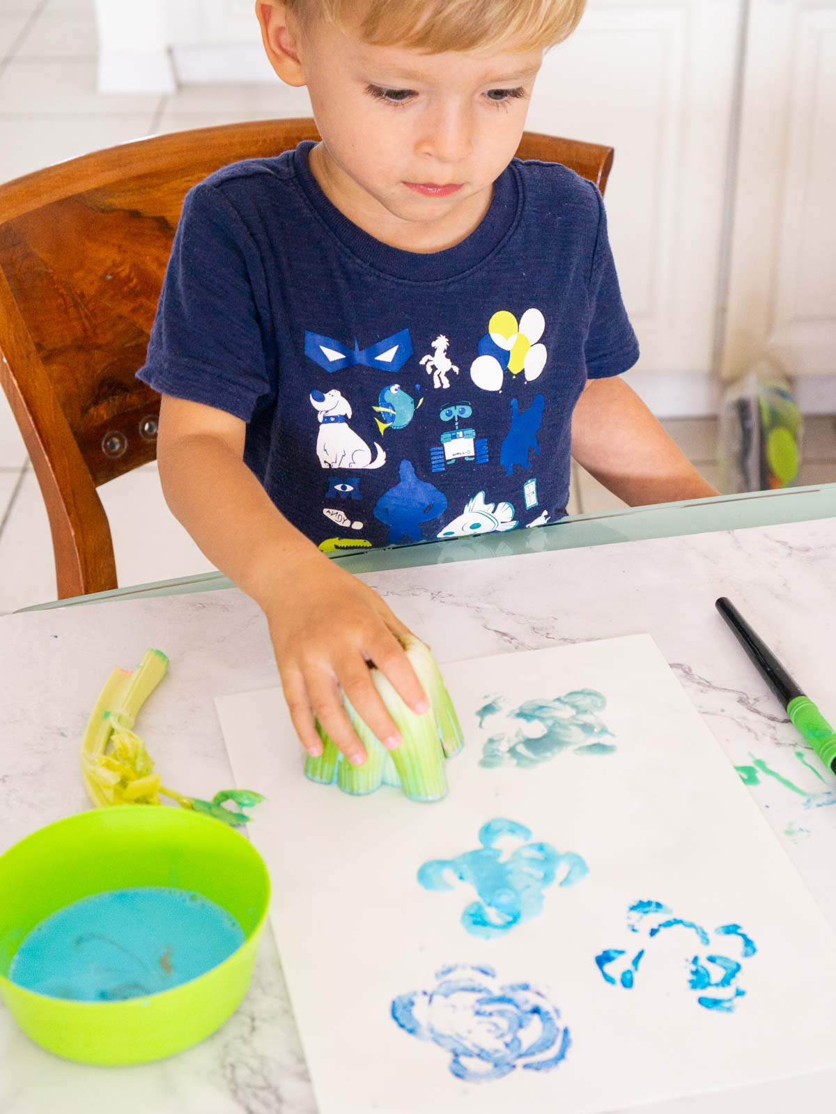 Toddler stamping with celery.