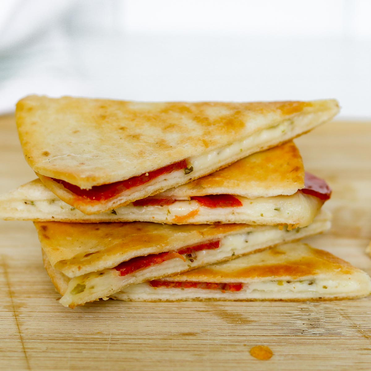 Stack of pepperoni pizza quesadillas.
