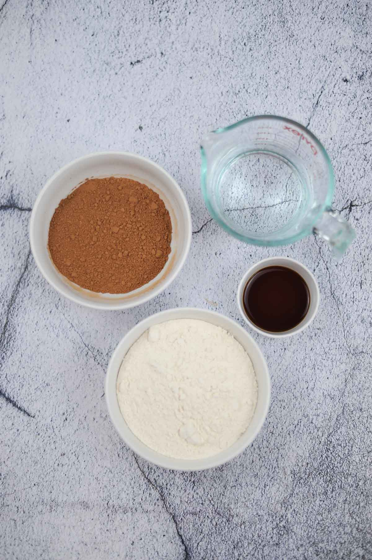 Ingredients to make Halloween pancakes: pancake mix, cocoa, water, vanilla extract.