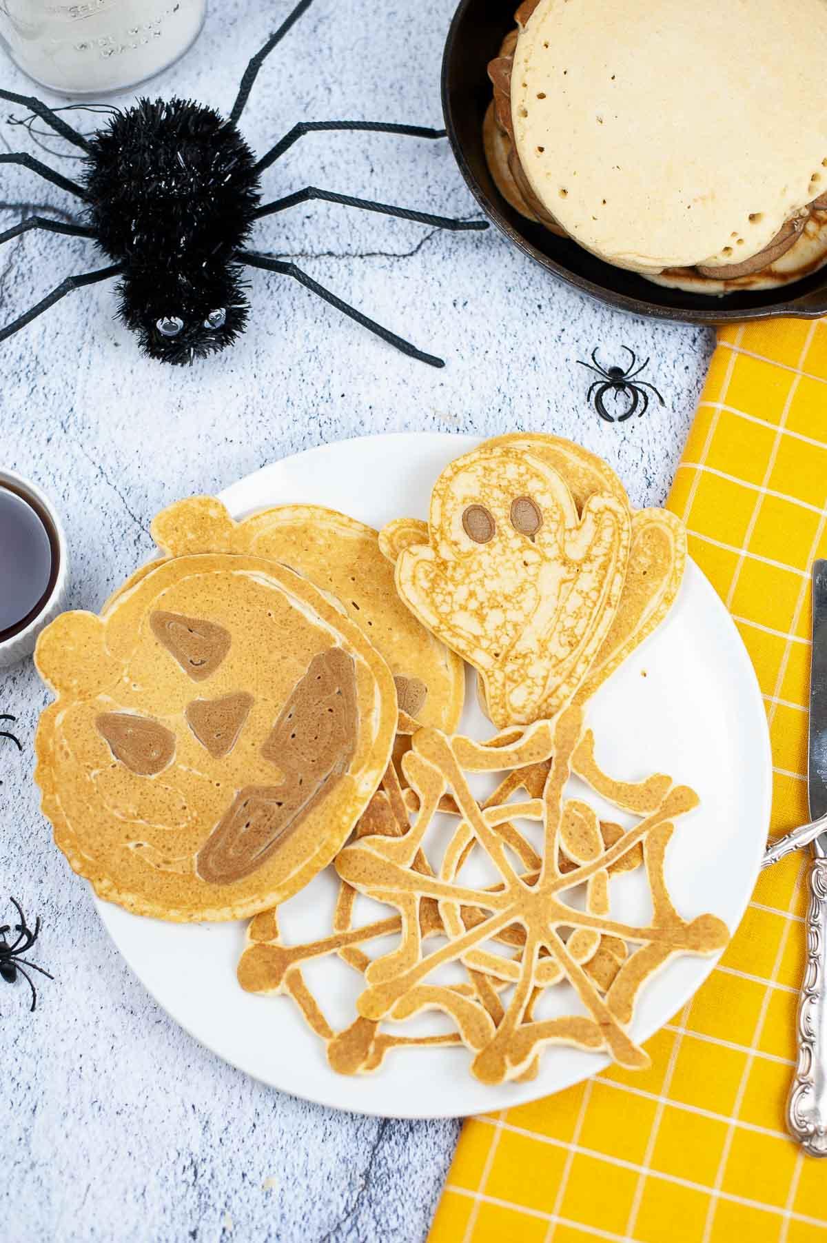 Halloween breakfast plate with Halloween shaped pancakes.